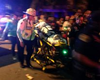 Mardi Gras casualties: Boy hit by float in Bacchus parade; policeman helping him slipped on beads and broke his leg.