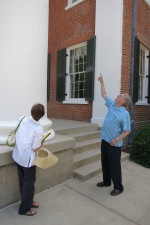 Jerry shows Claudia the bullet holes from the riot  in the Lyceum's columns.