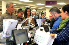 President Barack Obama and daughters shop