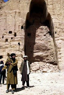 Taliban militia in front of what was once the tallest standing Buddha statue, which they destroyed.